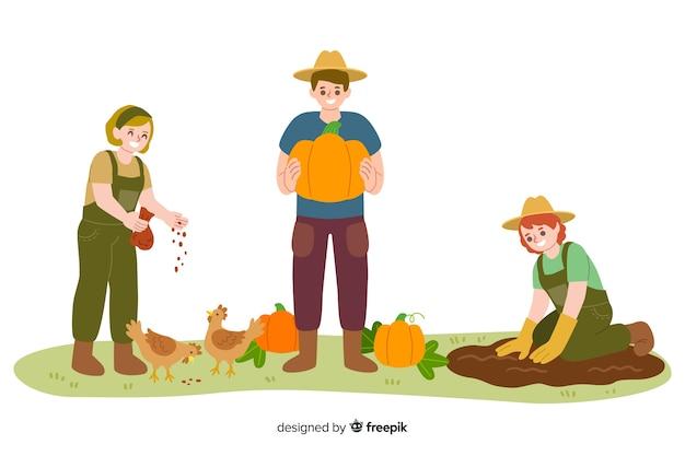 Lavoratori agricoli che danno da mangiare ai polli