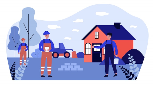 Lavoratori edili che riparano o costruiscono una casa di campagna