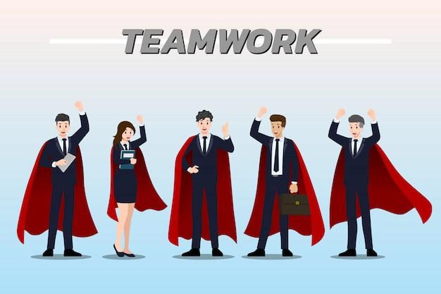 Lavoro di squadra dell'uomo d'affari che indossa mantello rosso.