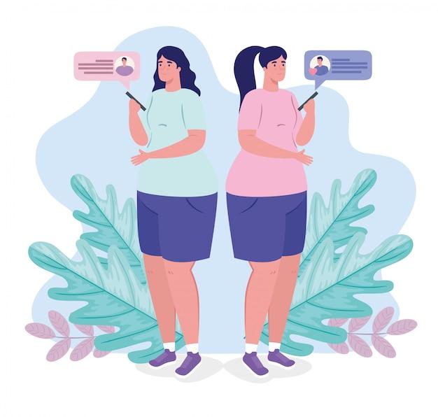 Le donne con gli smartphone in chat
