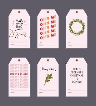 Le etichette del regalo di saluto di natale hanno messo con gli elementi dell'inverno e i desideri dell'iscrizione di festa