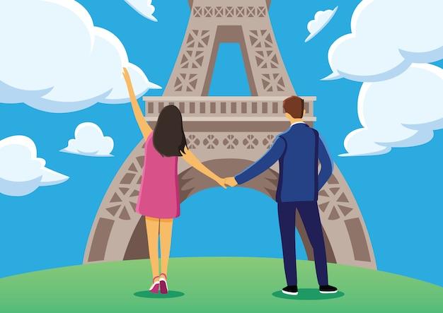 Le giovani coppie godono dentro vicino alla torre eiffel con cielo blu.