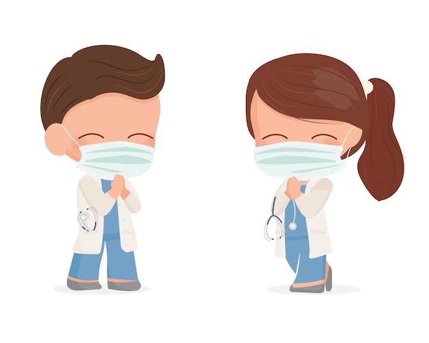 Le giovani coppie sveglie di medici con la maschera di protezione fanno il wai tailandese