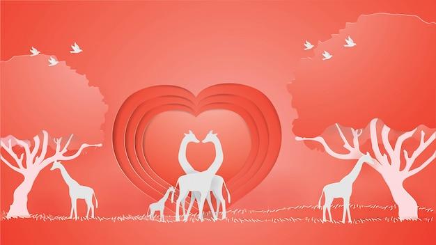 Le giraffe mostrano l'amore sullo sfondo rosso del cuore