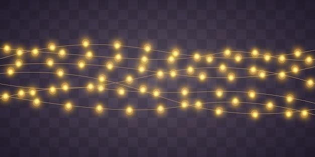 Le luci di natale gialle hanno isolato gli elementi realistici.