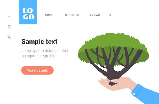 Le mani umane che tengono il pianeta di risparmi di giorno di terra dell'albero di acacia pregano per orizzontale di concetto dell'ambiente dell'ecologia dell'australia