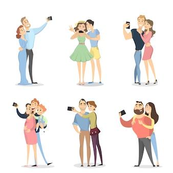 Le persone che fanno selfie. coppie con smartphone su bianco.