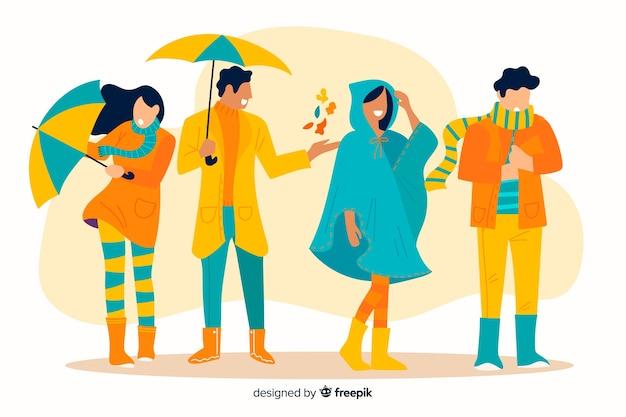 Le persone che indossano abiti autunnali