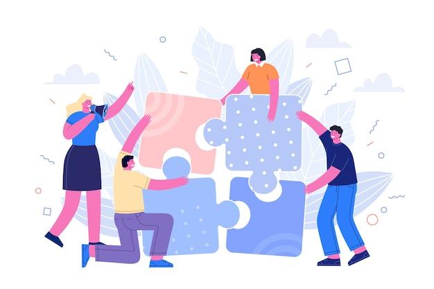 Le persone che uniscono i pezzi del puzzle