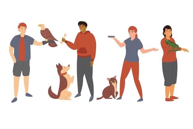 Le persone con diversi animali domestici insieme