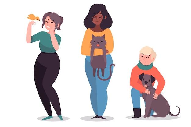 Le persone con simpatici animali domestici diversi