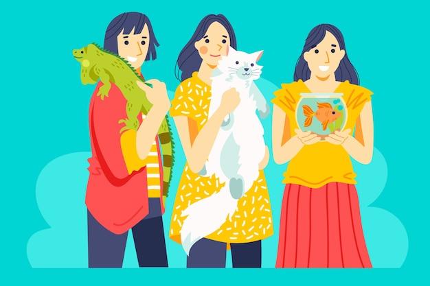 Le persone con vari tipi di animali domestici