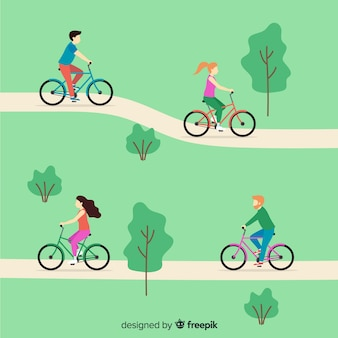 Le persone in sella a una bicicletta nel parco