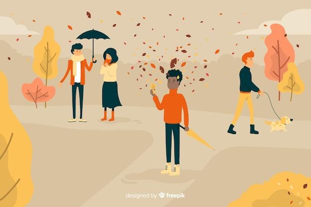 Le persone nel design del parco in autunno