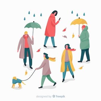 Le persone nel parco in autunno
