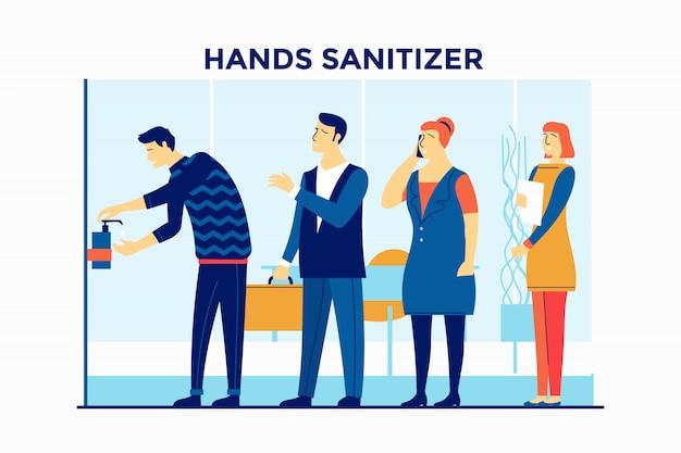 Le persone usano disinfettante per le mani nell'edificio per uffici per la prevenzione