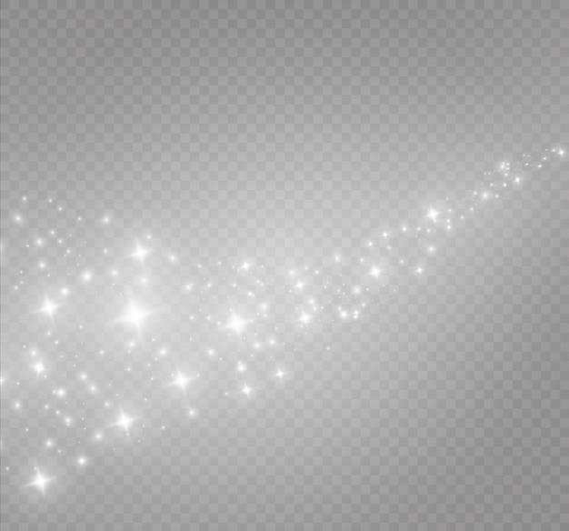 Le scintille di polvere e le stelle dorate brillano di una luce speciale. brilla su uno sfondo trasparente. scintillanti particelle di polvere magica.