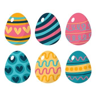 Le uova di giorno di pasqua felici disegnate a mano con i cuori progettano