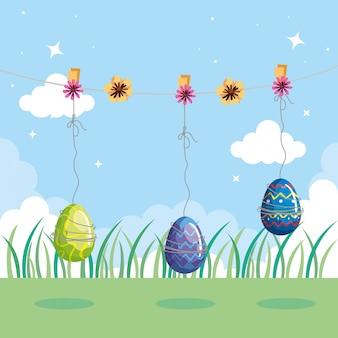 Le uova sveglie pasqua hanno decorato l'attaccatura con il paesaggio