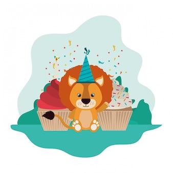Leone carino con torta di buon compleanno