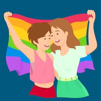 Lesbiche sventolando la bandiera arcobaleno lgbt celebrando l'orgoglio gay
