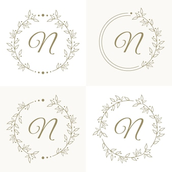 Lettera di lusso n logo design con modello di sfondo cornice floreale