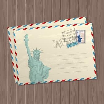 Lettere di stile vintage con la statua della libertà, segni e francobolli degli stati uniti