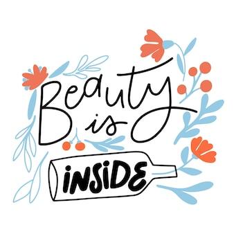 Lettering bellezza interiore con fiori