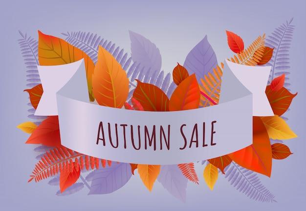Lettering vendita autunno con foglie arancioni e viola. offerta autunnale o pubblicità pubblicitaria