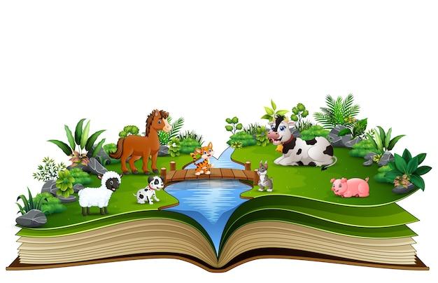 Libro aperto con fattoria degli animali nel parco
