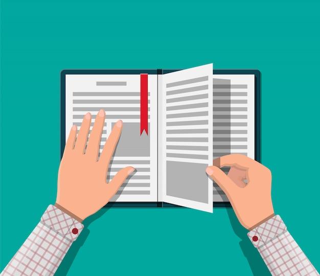 Libro aperto con una pagina rovesciata e un segnalibro.