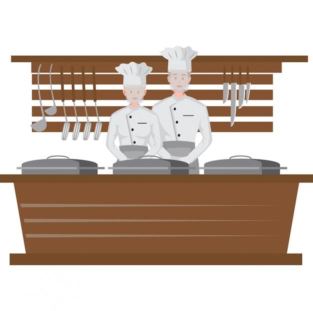 Lo chef lavora come al solito mentre usa la visiera durante la nuova normalità