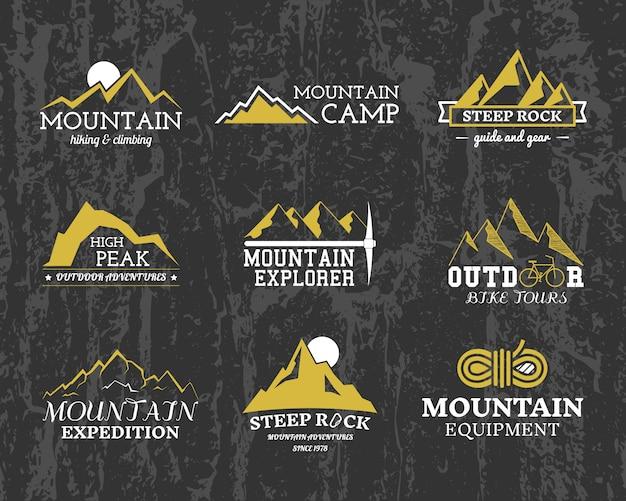 Loghi di esploratori di montagna, collezione di modelli di distintivi di campo. viaggi, escursioni, arrampicata. all'aperto.