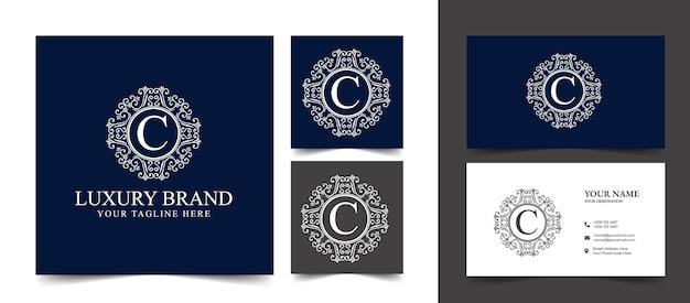 Logo calligrafico vittoriano di lusso retrò antico con cornice ornamentale