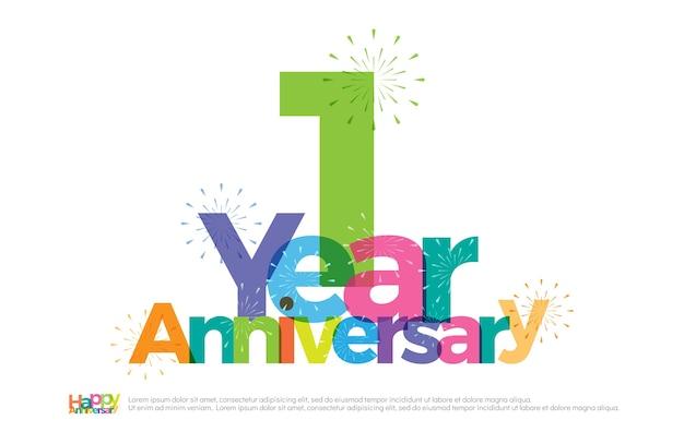 Logo colorato di 1 anno anniversario celebrazione con fuochi d'artificio