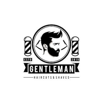 Logo del taglio di capelli del negozio di barbiere