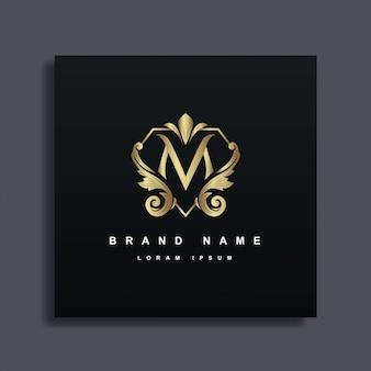Logo design di lusso con monogramma lettera m, colore dorato, lussuoso stile decorativo fiorito
