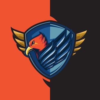 Logo di gioco esport con il tema dell'aquila rossa dalle ali blu. con la difesa dello scudo