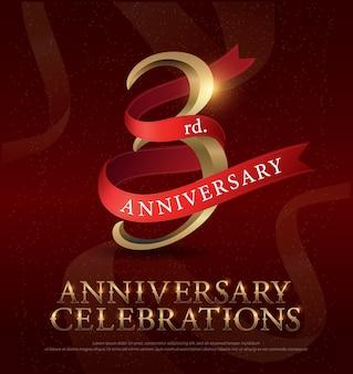 Logo dorato di celebrazione di anniversario di terzo anno con il nastro rosso