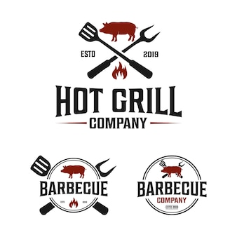 Logo vintage dell'azienda barbecue con spatola e forchetta