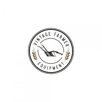 Logo vintage di attrezzature contadino