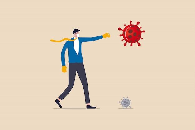 Lottando per le imprese per sopravvivere e fermare il concetto di crisi di scoppio del coronavirus covid-19, leader uomo d'affari sicuro che indossa tuta con guantoni da boxe in lotta con il patogeno del virus covid-19.