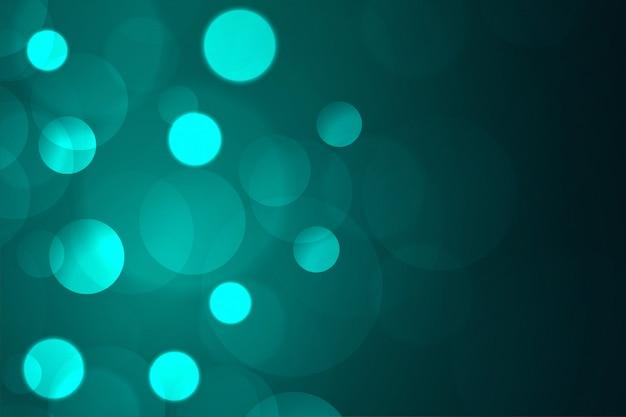 Luce blu astratta del bokeh su fondo scuro