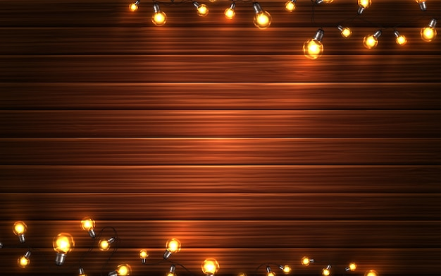 Luci di natale. ghirlande d'ardore di natale delle lampadine del led sul fondo di legno di struttura. decorazioni natalizie
