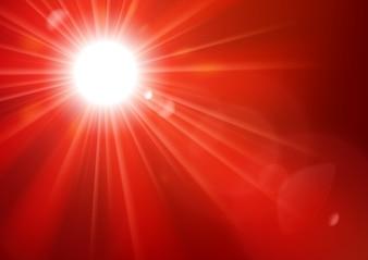 Luci rosse che brillano con sfondo lens flare