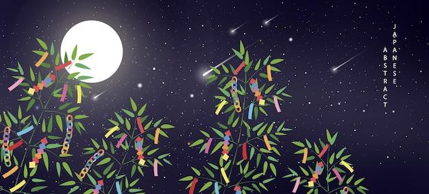 Luna di meteora del cielo stellato di notte estiva e rami di bambù con decorazioni colorate di nastro e tag