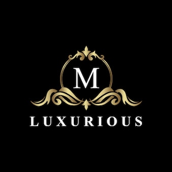 Luxury logo design con monogramma lettera m, colore dorato, fiorire di lusso