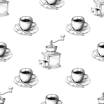 Macinacaffè manuale retrò o mulino e tazza di caffè su un piattino.