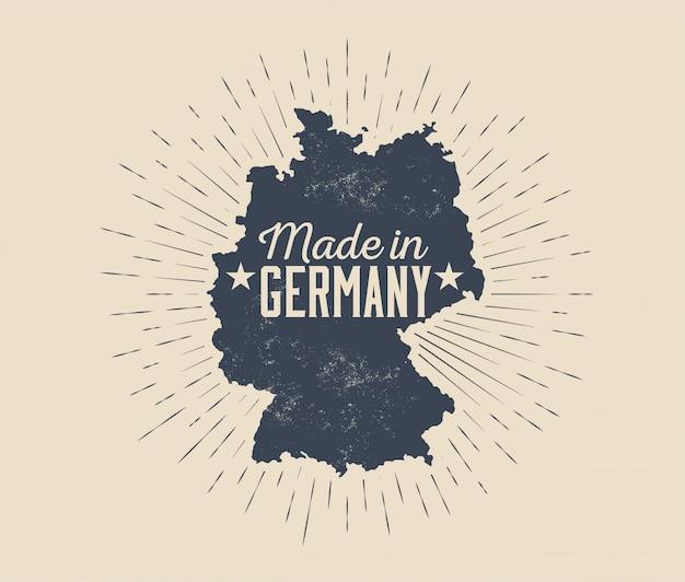 Made in germany badge o etichetta o tag modello di progettazione con silhouette nera della germania mappa con sunburst isolato su sfondo chiaro. illustrazione in stile vintage