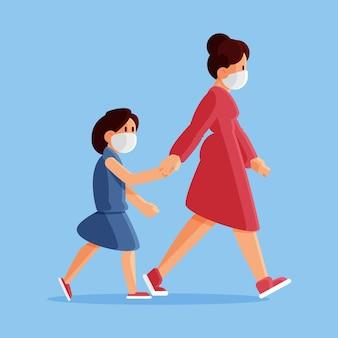 Madre che cammina bambino con mascherina medica